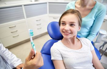 girl during the dentist checkup