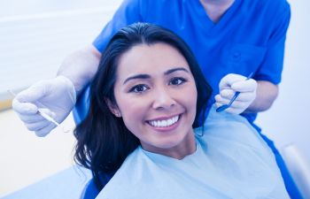 smiling woman during the dentist checkup
