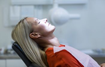 woman relaxing on the dentist chair